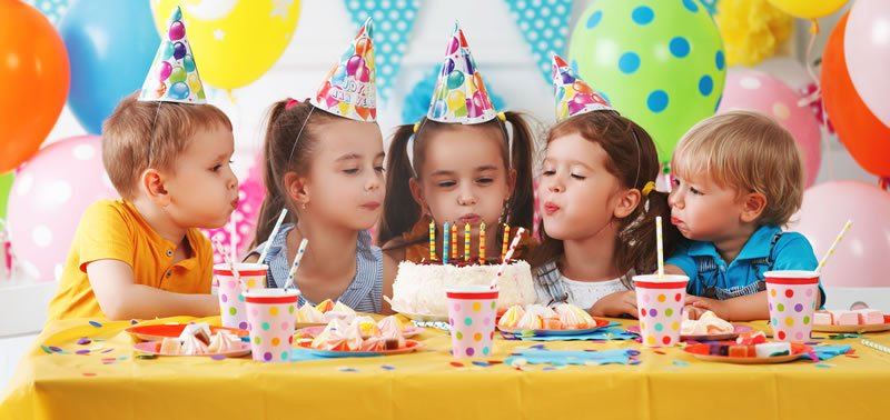 Childrens Birthday Party with Balloons and Cake